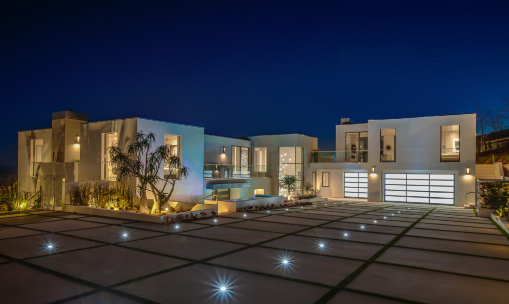 Night time photo of a large home